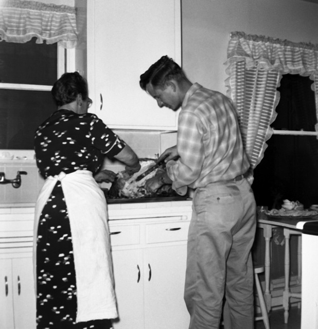 grandma and dad in the kitchen