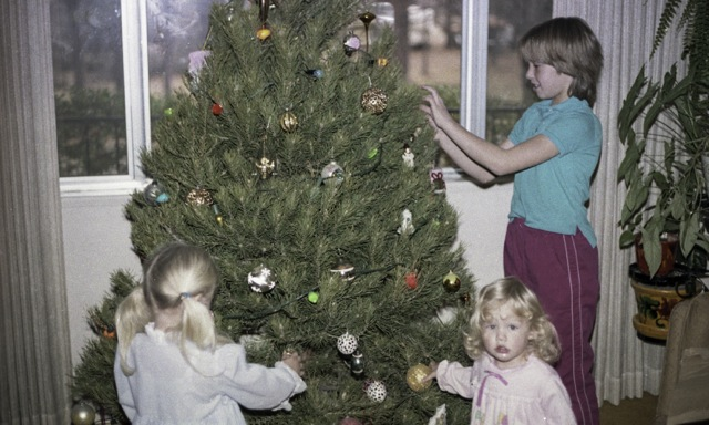Sean, Maeve and Colleen decorating their tree