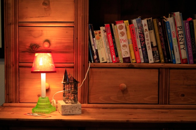 cookbooks, a lamp and a San Francisco Victorian