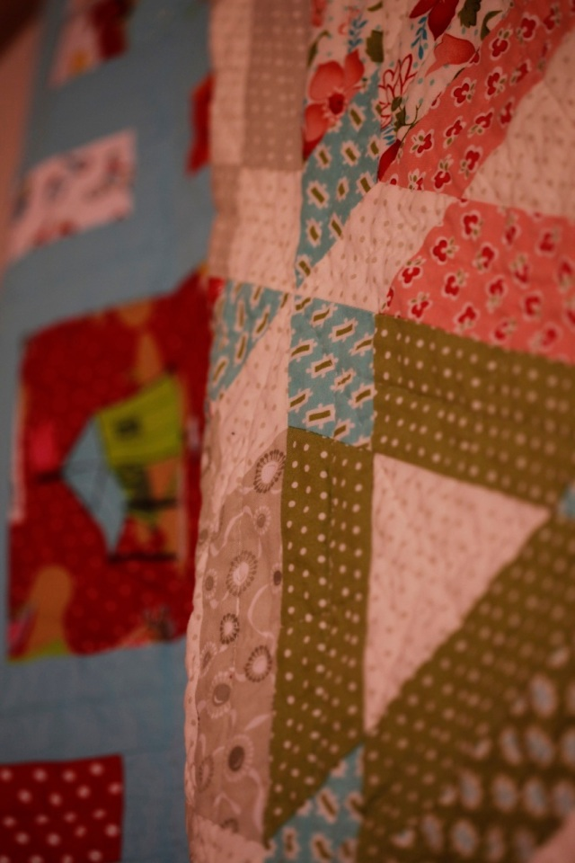quilts I made hang on a rod with easy access to snuggle under