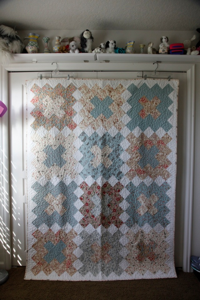 made with Papillon by Moda. Quilted by hand in a shell pattern.