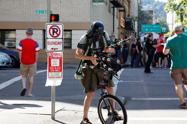 what the heck? he can be found all over Portland playing his pipes and riding his cycle