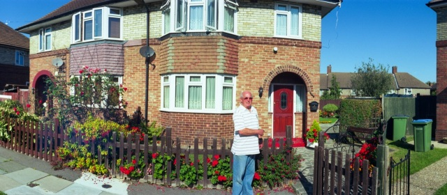 Ron in front of his home